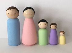 This basic pastel colored family is perfect for any child! This set includes 5 dolls of varying sizes. Tallest dolls are 3.5, smallest is 1. Great for imaginative play, dollhouses, classrooms or decorating. Painted with non toxic paint and sealed with non toxic sealant for