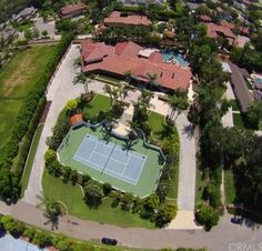 Tucked away on 1.7 acres of resort-like grounds in a privately gated enclave, this sprawling 7,250-square-foot estate boasts custom finishes, a gourmet kitchen, entertainer's pavilion and tennis court.