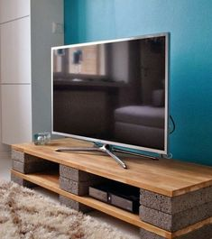 DIY Concrete Brick And Wood Man Cave Furniture TV Media Stand. Follow rickysturn/diy-home-decor