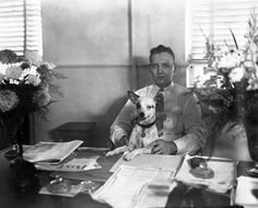 """Results showed that the groups who had a dog underfoot throughout the activity, """"ranked their team-mates more highly on measures of trust, team cohesion and intimacy"""" Dog at the office: Billy Belk with dog at the Leon County Clerk's Office in Tallahassee, Florida."""