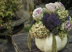 Fall Flower Arrangements..Love the idea of using pumpkins to create flower arrangements..