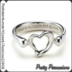 """Tiffany & Co. Elsa Peretti Open Heart Silver Ring Tiffany & Co by Elsa Peretti's most celebrated iconic ring in .925 sterling silver  Ring Size: 5  Inside stamped """"Tiffany & Co 925 Peretti Spain""""  Comes with Tiffany dust bag  Worn only a couple times as a pinky ring & midi ring. Beautiful condition  Original stock photo/cover photo of this ring from Tiffany & Co. ~ other photos are of actual ring you're purchasing. Ring looks a little darker due to being photographed on a dark granite…"""