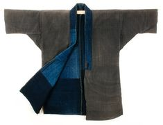 This is an antique Japanese workwear jacket called a noragi. The outside of this textile is made of heavy weight, handwoven, and handspun cotton. The jacket is a handsome pebble or stone color and there is no visible staining or damage to the outside of the coat. The collar is lined with natural indigo dyed cotton.