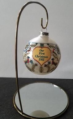 Check out this item in my Etsy shop https://www.etsy.com/listing/527830691/vintage-hallmark-ornament-our-first