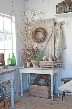 AWESOME neutral potting shed area - old clay pots, branches, grain sacks, trays, stool, old worn farmhouse tables, old glass bottles, lantern, wicker, wood floor - heavenly ♥