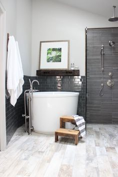 design indulgence High gloss subway tile next to textured tile, soaker tub, mantle over tub