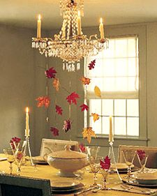 Tie the stems of two or three dried leaves along a strand of cord, then affix a heavy bead to the bottom to weight it. Repeat to make several cords, and carefully tie them to the chandelier. From Martha Stewart