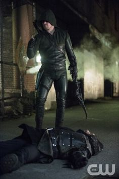 """Arrow -- """"Heir to the Demon"""" -- Image AR213a_0446b -- Pictured: Stephen Amell as The Arrow -- Photo: Cate Cameron/The CW -- © 2014 The CW Network, LLC. All Rights Reserved"""