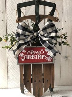 This is an amazing rustic Christmas sled you will treasure for years. Perfect for a front door, wall or propped by the fireplace. This farmhouse wooden sled measures 19 tall, 8 wide and 4 deep. Well made wood constuction, not lightweight at all. Has long jute cord for hanging and a gorgeous buffalo