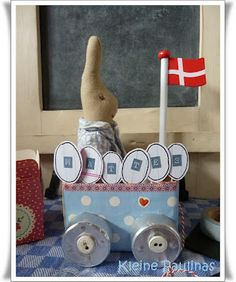 Could this be any cuter? Here comes bunny in his carriage made from Tetra Pak cartons, night light holders and buttons...