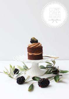 Chocolate almond naked mini cake with chocolate ganache buttercream and gilded blackberry