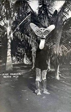 A Baining fire dancer wearing ceremonial mask, New Britain. Real photo postcard, c 1910's, printed on Kodak Austral stock (not postally used)