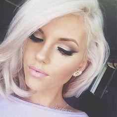 Asymmetrical platinum white blonde bob short hair