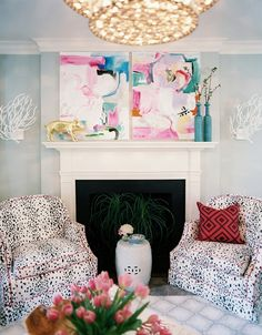 This room by Jamie Meares is fabulous.  I especially like the abstract paintings over the fireplace, the gilded pig on the mantel, and the speckled chairs.