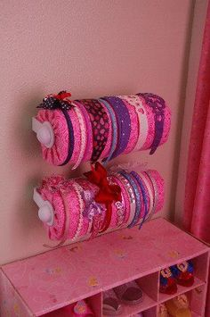 Another awesome headband storage idea - paper towel holder with paper towels covered with fabric. Yes, paper towels