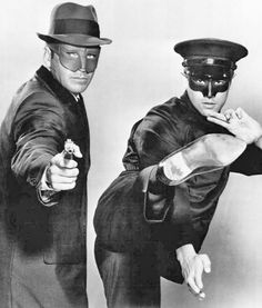 ‪Van Williams as the Green Hornet and Bruce Lee as Kato from the television program The Green Hornet ‬