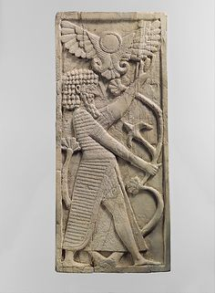 Panel with a male figure grasping a tree; winged sun disc above.  Period:  Neo-Assyrian  Date:  ca. 8th century B.C.  Geography:    Mesopotamia, Nimrud (ancient Kalhu)  Culture:  Assyrian