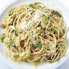 Spaghetti with Brussels Sprouts, Pancetta, and Hazelnuts ~ Another: http://www.twopeasandtheirpod.com/brown-butter-brussels-sprouts-pasta-with-hazelnuts/
