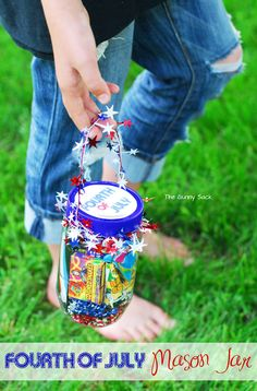 4th Of July Craft: A Gift In A Jar, how cute or even use a bucket with a shovel if you are near the beach.  BESURE to remember glass and kids, maybe use a plastic jar, etc . .   No ouches for the little ones.
