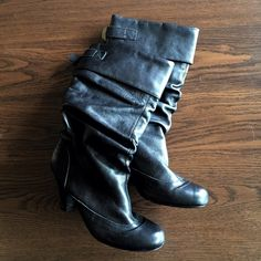 Heeled Leather Boots Black heeled boots with scrunched leather. About 3 inch heel. Very comfortable. Pre loved but lots of life left. Most wear can be seen on the heels. Price reflects wear. I can't remember what brand these are. Sorry :( Shoes Heeled Boots