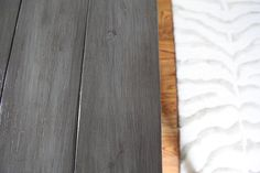 The table got sanded a couple of times with 80, 120, and 200 grit.  Then I used a can of old Alkyd paint to give it a nice warm gray color.  This was Sherwin Williams Amherst Gray.  After the paint, I sanded the edges and corners with 80 grit and then used Rustoleum's Kona stain to rub it all over.  When you do this, it takes some serious elbow grease to get the excess off but I think the finish is worth it.  Three coats of Polycrylic later, it is looking pretty fly for a gray guy.