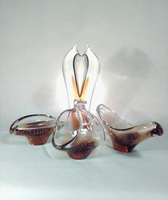 Skrdlovice art glass. Jan Juda. 1985.  A beautiful art glass set in clear and light brown, designed by Jan Juda for Skrdlovice glassworks in 1985. The set includes a tall vase with perfectly spaced spiraling bubbles, as well as, an elegant bowl and ashtray. Pattern: 8533 Vase --