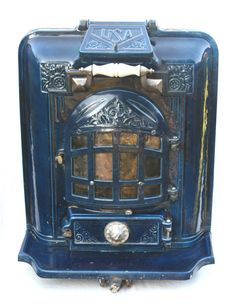 French Antique Cast Iron Stoves in coloured enamel. From Wood Burners to Art Deco multifuels + used Workshop Stove. antique stoves from France