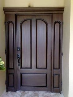 It is not just a front door it is a gate white trim and - Puertas de madera entrada principal ...