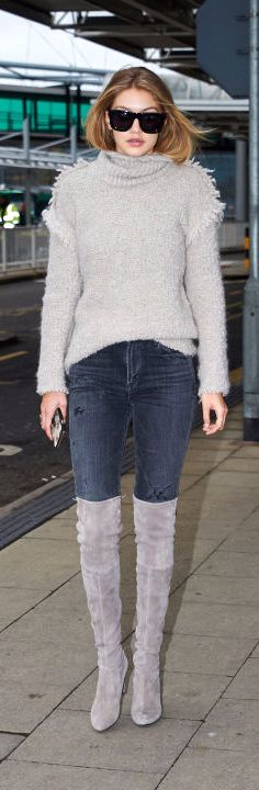 Gigi Hadid ♥ Arriving at London's Heathrow Airport in a gray turtleneck, jeans and suede over-the-knee boots.