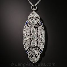 Art Deco Platinum, Diamond and Sapphire Pendant Necklace. A bright white and sparkling mélange of high-quality European, old mine and single-cut diamonds, totaling 2.75 carats, are artfully arrayed throughout this stunning Art Deco jewel, die-struck and beautifully hand finished in platinum - circa 1925. Measuring and impressive 2 inches long, the oval, geometrically filigreed plaque centers on a trio of European-cut diamonds shining from within double, delicately milgrained octagonal…