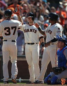 Buster celebrates with Kelby Tomlison after the rookie's first career home run, a grand slam.