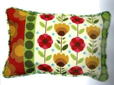 A 60's revival brightly coloured flower cushion.