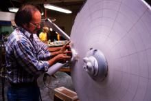 Jim Dow in 1978 working on the USS Enterprise filming miniature for Star Trek: The Motion Picture with the original Bridge superstructure clearly visible. (Image: Courtesy Richard Taylor)