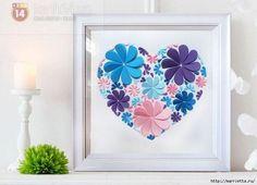 Você pode fazer um coração com flores de papel para enfeitar o seu espaço ou a sua festa, podendo até mesmo posicionar este coração na parede atrás do b