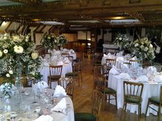 All of the centerpieces together for this lovely winter woodland wedding we did last week. These tall martini vase arrangements looked of pride and place in this beautiful Rustic barn setting
