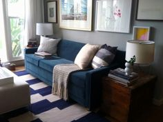 blue couch, grey walls