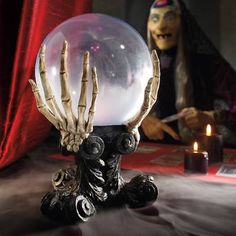 Gaze into the future plan for many pleasures ahead, courtesy of our Glass Crystal Ball. Nothing takes a Halloween party from ho-hum to howling-good-fun faster than a fortune-telling table this, my ghoul, is the perfect Halloween prop. Three skeleton hands extend from a gothic-style platform to hold this mystical glass orb, frosted on the bottom and lit from within. Interior glow changes color for a convincing show of otherworld activity. Start preparing your act. ...