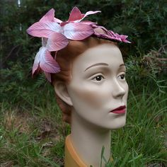 Crown yourself in a cute garland of pink flowers. Floral garland on a figure-eight base.