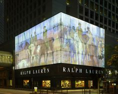 """The exterior façade of our Men's Flagship store in Hong Kong boasts a unique fabrication of glass with a large mural that features renowned French painter Octave Denis Victor Guillonnet's """"Bridle Path at Hyde Park"""". The painting comes from Ralph Lauren's private art collection and brings about the equestrian heritage that the World of Ralph Lauren luxuriously embodies."""