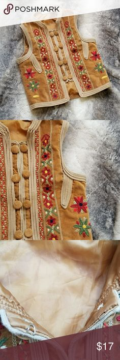 Mary-Kate and Ashley Boho Embroidered Floral Vest *** Good USED Condition ***  Mary-Kate and Ashley Groovy Hippie Boho Style Embroidered Floral Vest   Size: Girls L (10-12)  - 100% Cotton Body - 100% Polyster Lining  Measurements: Armpit to armpit: 15 in. Shoulder to bottom hem: 16.5 in. Mary-Kate and Ashley Jackets & Coats Vests