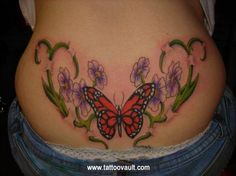 Red butterfly tattoo on lower back