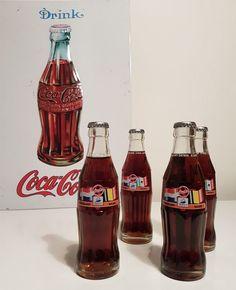 Online veilinghuis Catawiki: Groot metalen Coca - Cola bord in relief / 4 vintage coca cola flesjes