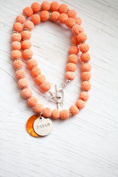 Orange sponge beads necklace with Dream accent