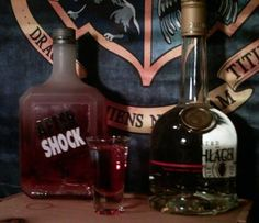 Gryffindor  the house of lion  Quite bold, best for the brave of heart  1/2 Cinnamon Aftershock  1/2 Goldschläger  First layer the Aftershock, then layer the Goldschläger on top. It's best if you shake the Goldschläger first so you can get some gold flakes.