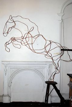 The flow in the wire gives a implication of movement and strength to the sculpture