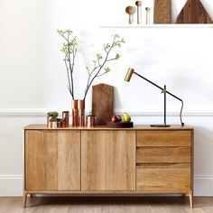 This mid century style wooden unit is perfect for storing away unnecessary clutter in your hallway whilst being a side board for displaying your favourite objects and style.