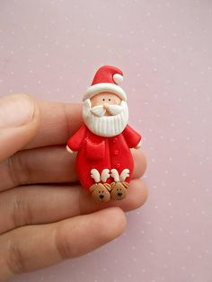 Christmas brooch created from polymer clay without using molds. With Santa Claus with cute reindeer slippers. The size of the pin is 4.6 cm. ❀ Because i make everything by hand, the item you receive may differ slightly than shown on the pictures. ❀ Price is for one Christmas pin. ❀ I ship