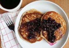 Rustic sour-milk pancakes make for a delicious breakfast, especially when topped stewed blueberries and maple syrup.