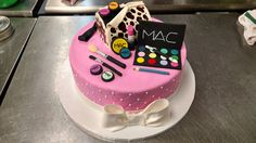This ten inch fondant covered cake is draped in fondant makeup, ribbon, bow, and carved cake makeup case.
