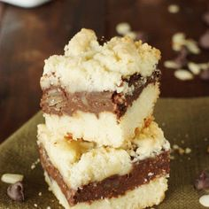 Chocolate Layer Bars (Printable recipe) Recipe Desserts with all-purpose flour, granulated sugar, baking powder, unsalted butter, margarine, eggs, almond extract, semi-sweet chocolate morsels, cream cheese, milk, slivered almonds